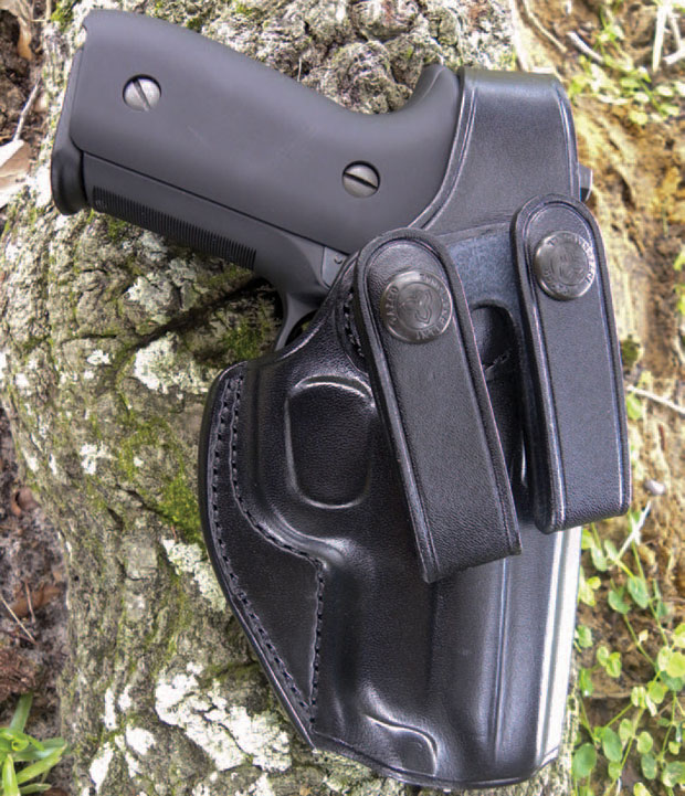 Review on Galco SC2. The cut of the holster permits a proper firing grip on the draw and the reinforced leather retains its shape to aid reholstering.