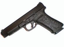 Defensive Shooting: Some handguns, like the Glock line, can be customized to better fit the owner's hand. Here, a Glock 35 has had a grip reduction and finger channels, which aid greatly in getting a proper grip with smaller hands. The newest Generation 4 Glocks, and the Smith & Wesson M&P, feature interchangeable grip inserts which serve the same function.