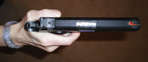 Defensive Shooting: Note the gap between the trigger finger and the pistol's frame.