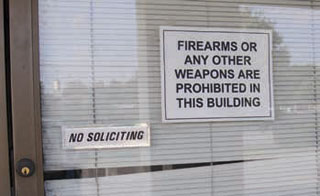 Carry License: An example of an illegal sign (wrong size). This sign appears on the Liberty Missouri Driver's License Bureau, which has responsibility for issuing the License To Carry.
