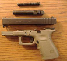 Disassembled Glock pistol ready for cleaning