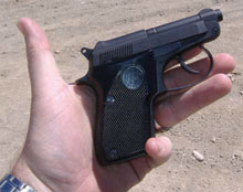 It has a little wear around the edges, but still looks cool. Kinda like a mini Beretta 92