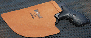 A single piece of leather, cut and stitched just right, yields an effective pocket holster.
