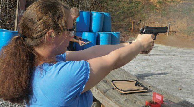 Emily Campbell blasting away with the full size Taurus 9mm pistol. She has mastered the type through long practice.