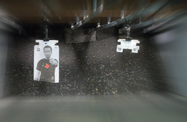 Target with stick-on spot placed at 15 yards to accurately determine relationship between point of aim and point of impact.