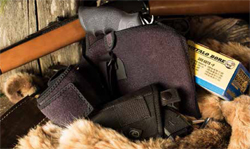 "Concealment concerns change when you head out to the woods. Not only is the clothing involved different than at the office, many folks opt for ""more gun."""