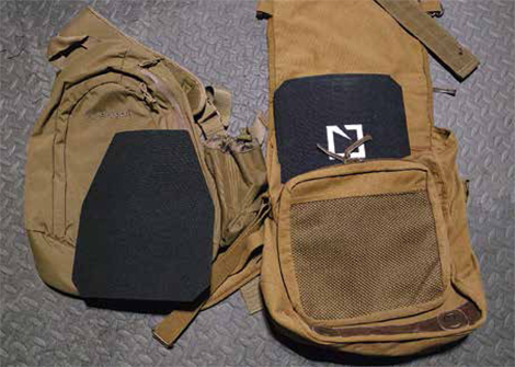Rifle-Proofed plates slipped into shoulder bags