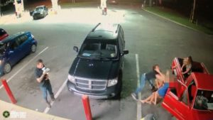 Security camera footage of a white woman assaulting another white woman and her children in a Florida gas station parking lot