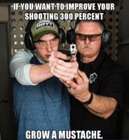 A dank meme featuring a mustachioed USCCA instructor showing a male student proper pistol grip and stance - the caption reads IF YOU WANT TO IMPROVE YOUR SHOOTING 300 PERCENT, GROW A MUSTACHE.