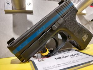 Black Kahr PM9 with a special edition thin blue stripe running down the side of the slide
