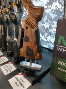 Distinctive woodgrain stock of a CZ-457 .22 varmint rifle on a trade show display