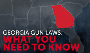 A dark gray map of the United States with state borders presented in white lines and the state of Georgia highlighted bright red. The title reads GEORGIA GUN LAWS: WHAT YOU NEED TO KNOW in all capital letters.