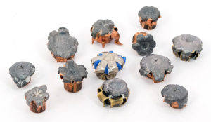 A group of 12 flattened bullets of differing weights and calibers demonstrate how hollow-point ammo expands during contact