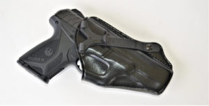 A black Ruger Security-9 semiautomatic pistol encased in a black leather holster from Galco Gunleather