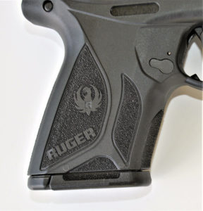 Detail of the textured grip on a Ruger Security-9 compact 9mm concealed carry pistol.