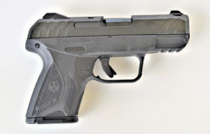 A Ruger Security-9 compact 9mm concealed carry pistol facing with the barrel to the right over a white background