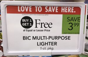 """A paper point-of-purchase retail sign advertising """"Buy One, Get One FREE"""" (BOGO) Bic lighters."""