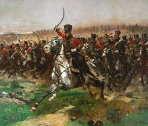 "A painting called ""Vive L'Empereur"" painted in 1891 by Edouart Detaille. The image depicts the 4th Hussars cavalry in red uniform, fur hats and with curved sabers charging across a battlefield on horses."