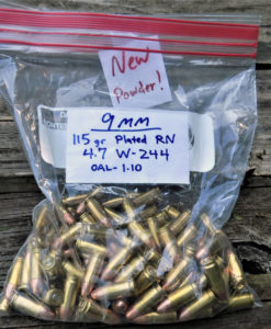 A gallon Ziplok bag of handloaded 9mm ammunition which is labeled with weight and manufacturing data.