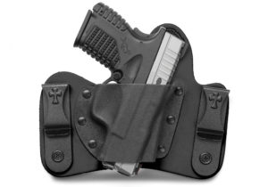 A black leather and Kydek hybrid IWB holster by Crossbreed, shown holding a two-tone silver and black semi-automatic handgun