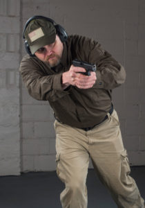 Concealed Carry Magazine Executive Editor Kevin Michalowski maneuvers as he brings a pistol up to fire with both hands