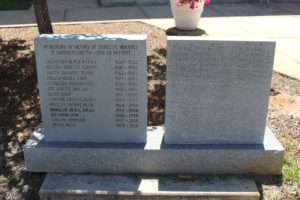 A stone monument to victims of domestic violence stands on Courthouse Square in Quincy, Florida.