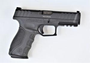 A Stoeger STR 9 semi-auto 9mm pistol lying on a white background.