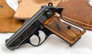 A Walther PPK/S with wooden grips perched on a white backdrop.