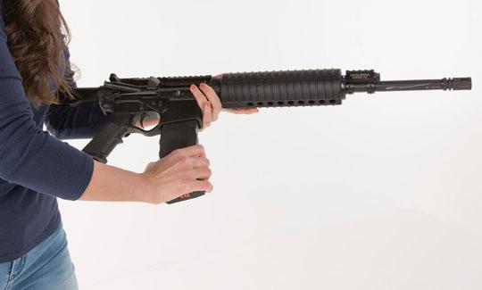 Woman holding AR-15