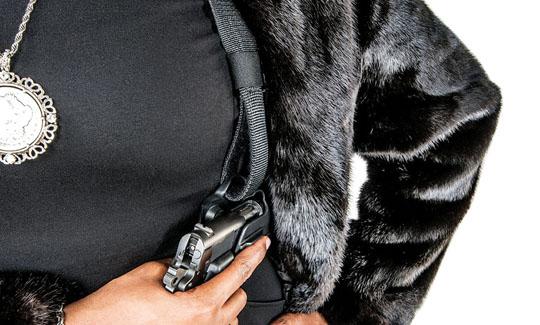 person wearing shoulder holster